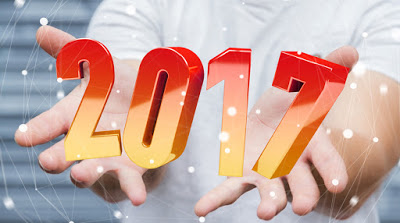 Businessman holding colorful 2017 3D rendering text in his hand